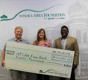 Sonora Area Foundation Board President. Mark Kraft presents check to ATCAA Food Bank Director Deni Avery and ATCAA Executive Director Raj Rambob